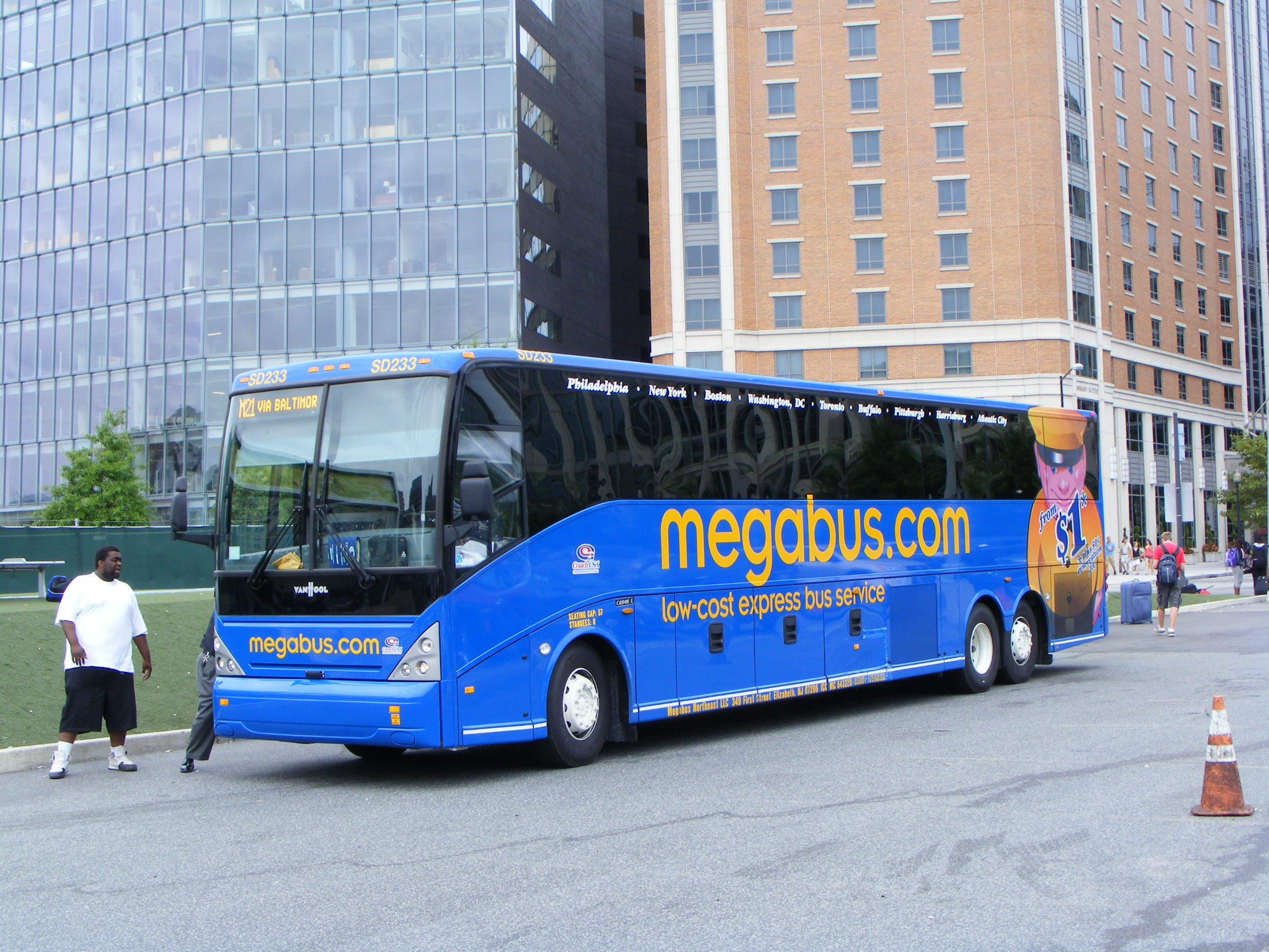 Awaiting departure on the M21 - Washington - Baltimore - New York from the  Washington terminus is Megabus Van Hool C2045E SD223 in August 2010.